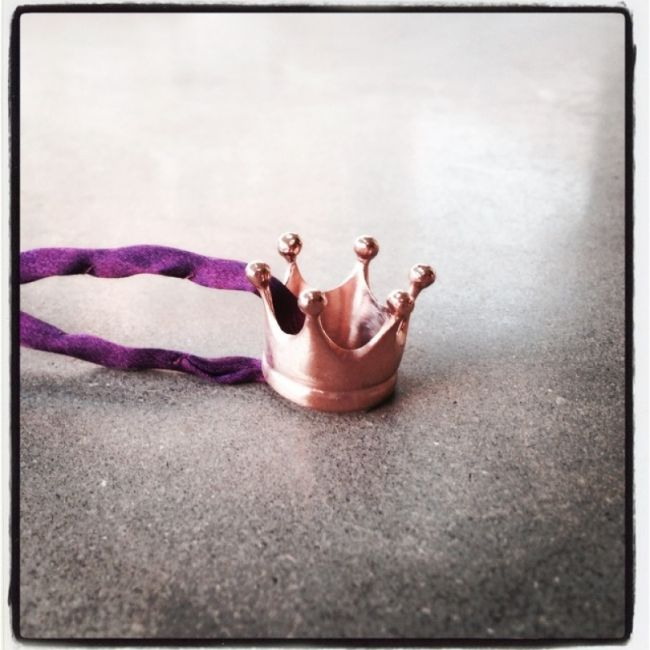 Necklace with crown as our company logo Crystal Queen from pink gold-plated silver with matte texture in a purple silk lace Price: 39€