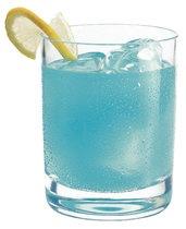 """Air Force One""     2 oz Hpnotiq Liqueur  1 oz citrus vodka  juice from a lemon wedge  lemon-lime soda  lemon spiral for garnish"