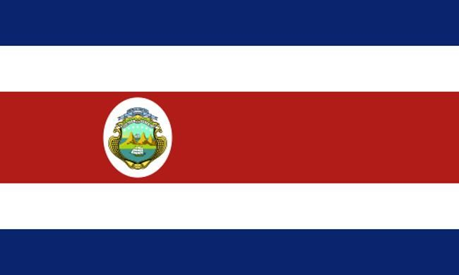 """Flag - In the flag of Costa Rica, the blue represents the sky, the white symbolizes clear thinking, and the red expresses the warmth of the Costa Rican people. The National Shield displays three volcanoes and a valley between two oceans, each one with a merchant ship. These represent the nation's trade with the rest of the world. The sun represents their prosperity. The branches represents their peaceful nature. The shield has golden circles that represent coffee, also known as """"golden…"""
