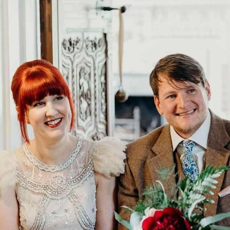 I can't believe we've been married almost a month! Probably time for me to share some photos of our big day! Our photographer @clarekinchinphotography took some amazing photos but I love this one as we're signing the register as we both look so happy ... and you can see my feathery shoulders lol!