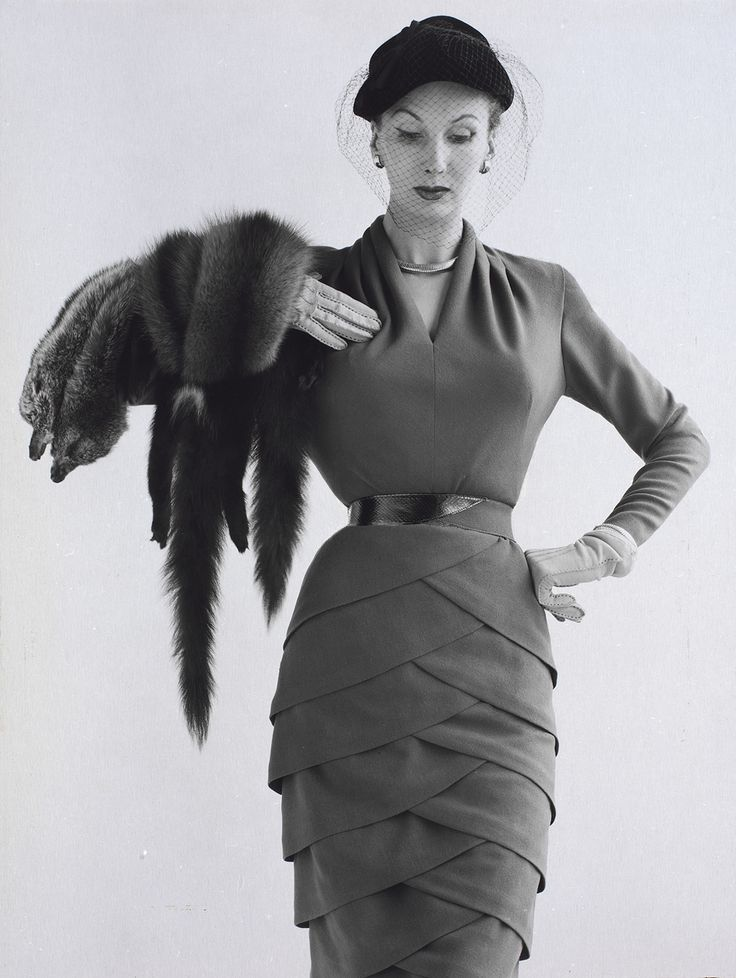 model Barbara Goalen, wearing a dress designed by Lily Schroter. Photographed by John French for Harvey Nichols advertisement in Vogue October 1951.