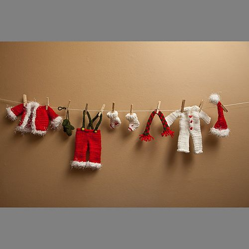 Mini santa clothes garland. Kit to knit includes yarn, pattern, clothespins and buttons. Makes 2 sets. Currently on sale for $16.97.