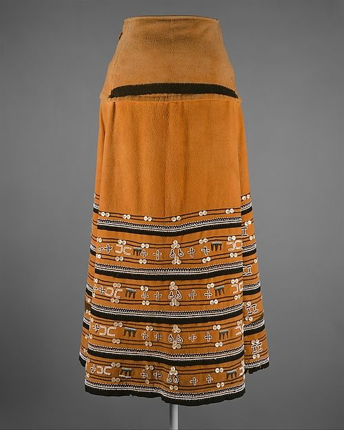 Skirt (Isikhakha or Umbhaco) Date: 20th century Geography: South Africa Culture: Xhosa or Mfengu peoples Medium: Cotton, wool, glass beads, shell buttons, ochre pigment
