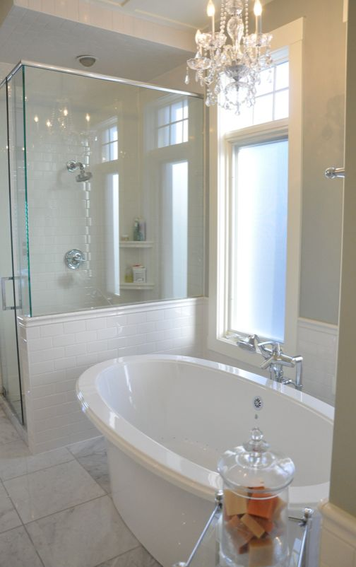 classic white bathroom design~ like these floor tiles and the subway....it is a bit sterile but if you added some organic textural components it could work. Nice tub