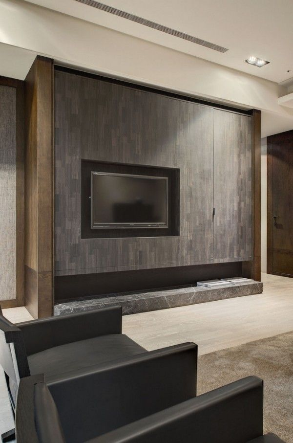 This type of focal wall provides a great solution for homes that are not equipped with the necessary setup for installing a working fireplace, and this design ingeniously incorporates concealed storage that's perfect for hiding away DVDs and games too.