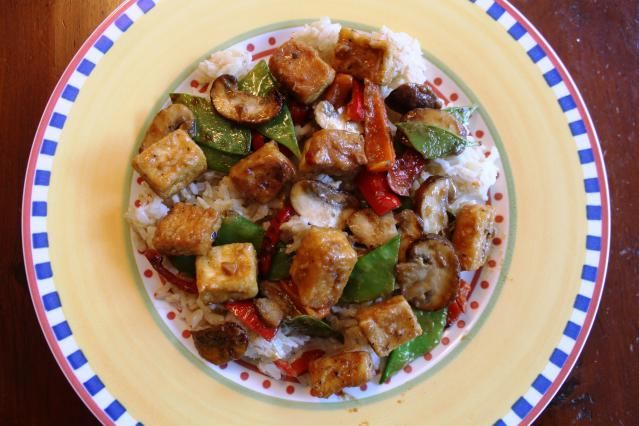 """Here's a Full List of Vegetarian Chinese Recipes You'll Want to Try: Pictured: <a href=""""http://vegetarian.about.com/od/tofurecipes/r/tofustirfry1.htm"""">Vegan tofu stir-fry with shiitake and snow peas</a>"""