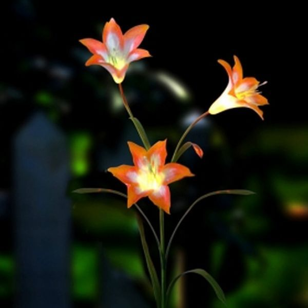 Solar Powered Garden Lights | solar powered led flower light collects the solar energy during the ...
