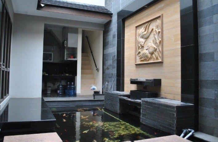desain kolam ikan indoor rumah minimalis modern