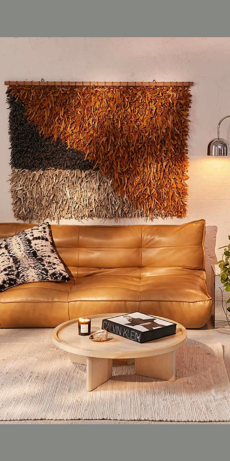 Genuine leather shag wall hanging in a colorblock design that makes the perfect modern-boho statement behind your bed or above a couch. #homedecor #wallart #artwork #anthropologie *aff*