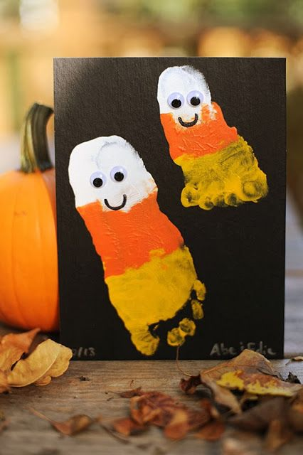 Candy corn footprints. This site also has cute finger painted pumpkin art idea.