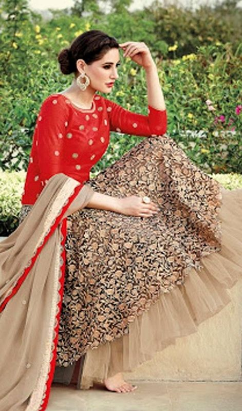 Dazzle the crowd with your marvelous looks just like Nargis Fakhri dressed in this beige net lehenga choli dress. Beautified with floral patch, lace and resham work. #BollywoodStyleLehengaCholiCollection