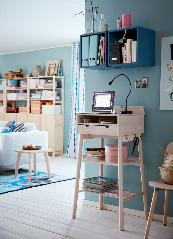 A corner in the living room with a standing desk where you can read your e-mails, pay your bills and keep your keys.