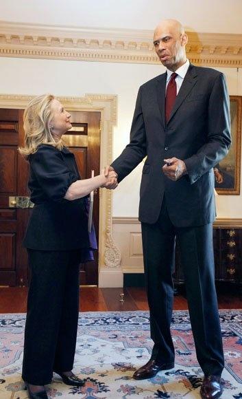 U.S. Secretary of State Hillary Clinton (L) meets with Cultural Ambassador Kareem Abdul Jabbar