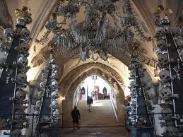 Prague - the cathedral adorned with human bones. Chandeliers, monuments, archways and more are decorated or made entirely from the remains of human beings. Morbid yet fascinating for me. I would love to go.