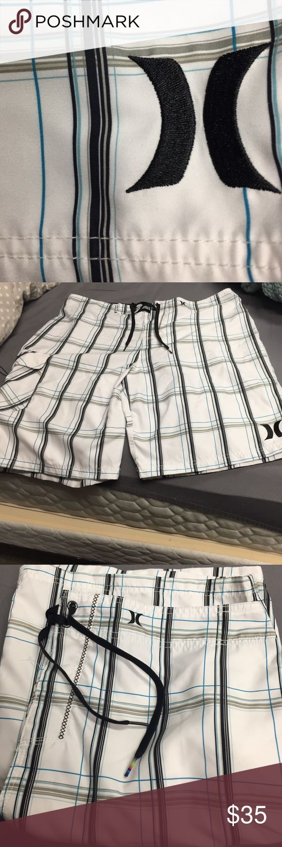 Hurley Board Shorts. NWOT. Size 38 Perfect Condition. Every guy needs pairs of board shorts, these are cool minus the cheesy.  Velcro Side Pocket w Cord and Colorful tip in Drawstring. Size 38 Hurley Swim Board Shorts
