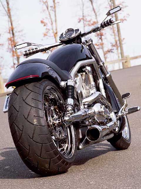 Harley Davidson V Rod. Not sure who did it but it looks like there's quite a bit of custom work on this bike. I love how it stands out but it's not gaudy. And it actually looks rideable.