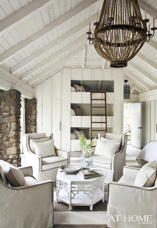 Sitting Area In A Lakeside Cottage Bedroom With Vaulted Ceilings, A Large  Chandelier, Four Arm Chairs Surrounding An White Octagon Table, Built Into  The ...