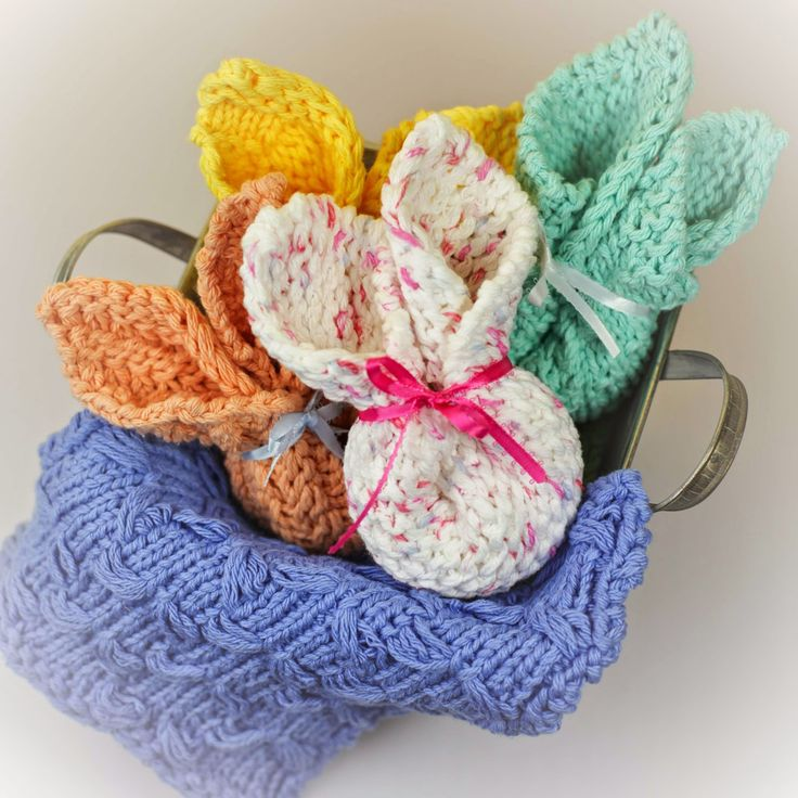 Loom knit washcloths folded into a bunny shape.
