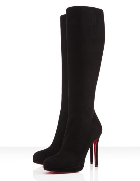 "The ""New Simple Pump"" has been a Louboutin favorite for many seasons past because of her thin platform that makes walking in her 120mm heel a breeze. The ""New Simple Botta"" is the classic boot that exemplifies these same traits. Once you fall in love with her in 2011 there is no question that the relationship will be long-term.  COLOR:Black  MATERIAL:Suede  Heel Height: 5 inches approx. - 120 mm approx.  Arch: 4 inches approx. - 100 mm approx.  Platform Height: 1 inches approx. - 20 mm…"