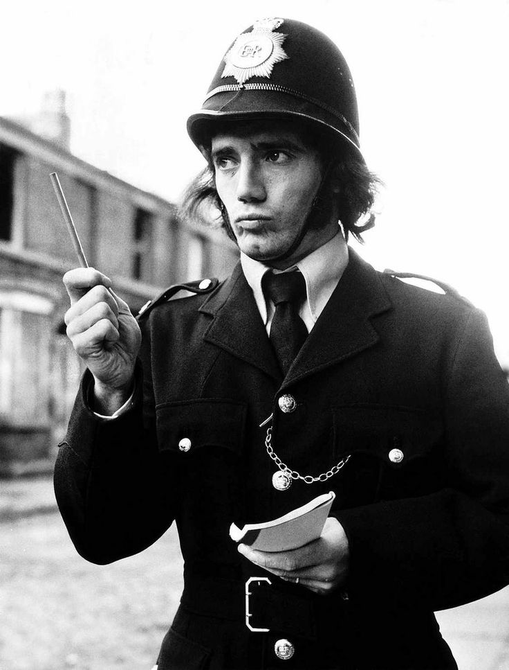 Liverpool footballer Kevin Keegan dressed up as a policeman including bobby's helmet November 1972