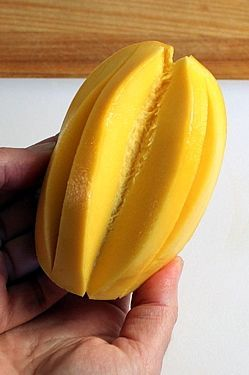 How to cut a mango. An easy, step-by-step tutorial. www.theyummylife.com/how_to_peel_and_cut_a_mango
