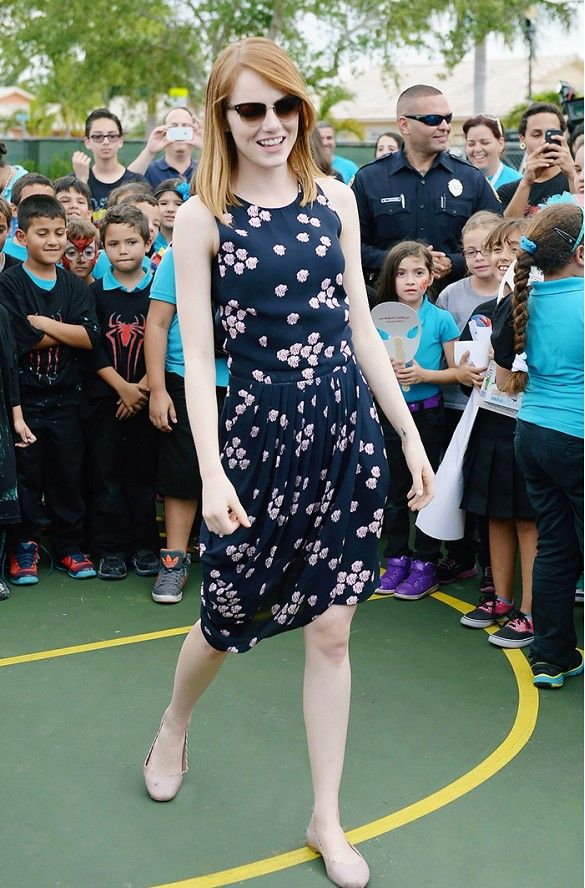 Emma Stone in floral dress with flats and cat-eye ...