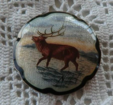 O.F. Hjortdahl, Guilloche pin with reindeer.
