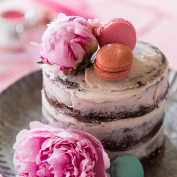 NAKED CAKE - This unique cake's decorating technique spreads the frosting on the cake leaving the layers exposed giving it a 'naked' appearance.