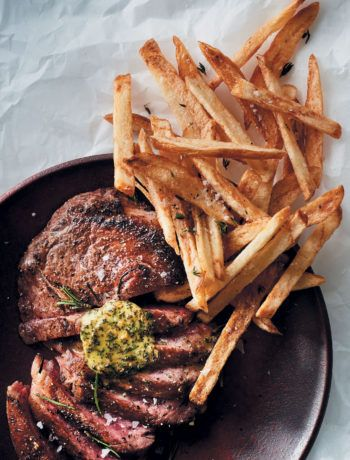 Pan-fried rib eye steak with herbed butter and skinny potato chips recipe