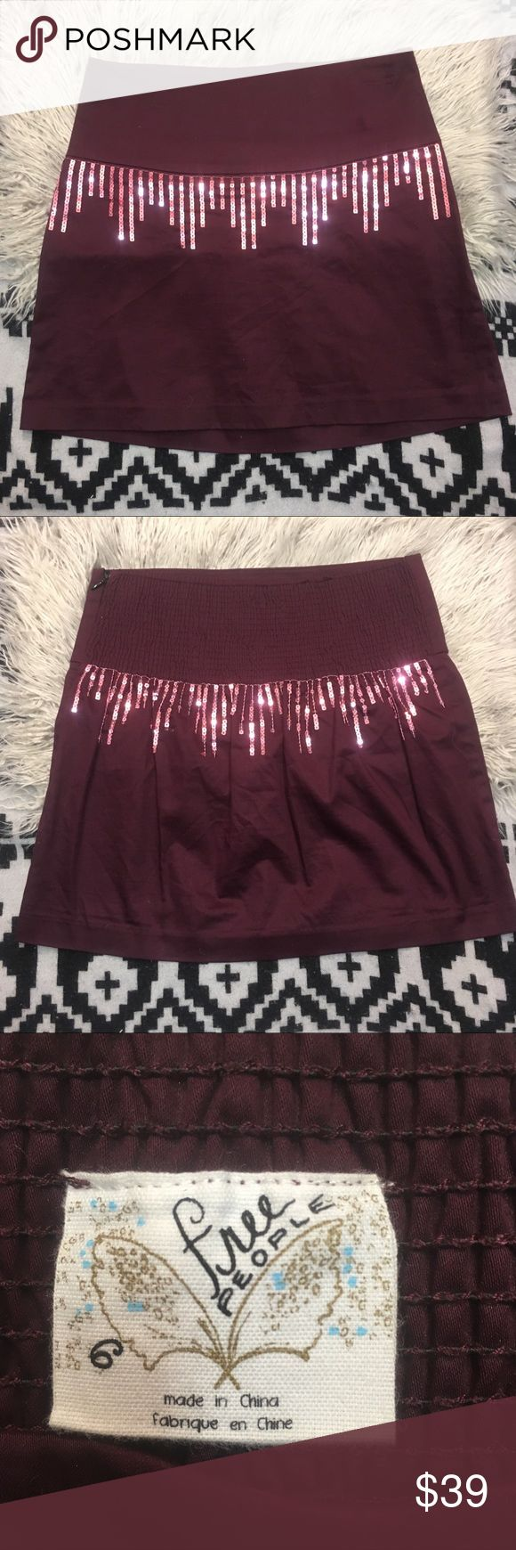 "Free People Bordeaux Sequin Mini Skirt Sz 6 Free People Bordeaux Mini Skirt Embellished with Sequins Sz 6. This skirt is constructed of a soft crisp cotton spandex blend with matching sequins. Side zip and wide back elastic smocked band. This is meant to be worn as a high rise, however the significant stretch in the waist allows for you to wear this lower on the hips as well. 15"" Length and 14"" Waistband. free People Sequin Maroon Bordeaux Mini Skirt Sz 6 Free People Skirts Mini"