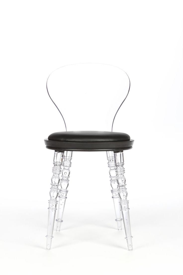 Стильный дизайн стула Icicle граничит с причудливостью: прозрачные ножки  из полиуретана выглядят точь-в-точь какледяная сосулька, отсюда и  название — icicle (в переводе с английского — «сосулька»). Из-за ножек и  спинки изделие выглядит хрупким...