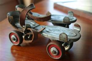 old roller skates from the 60's. Two kids + one pair of skates = add a book on each skate and both can play!  We sat on them and scooted all over the basement - untill mom noticed we were leaving marks in the concrete.