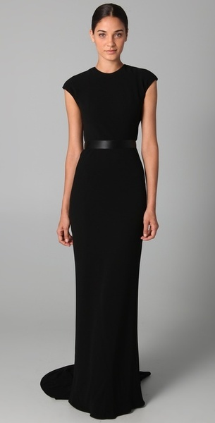 REEM ACRA  Cap Sleeve Gown with Lace Back Detail  This crew-neck, cap-sleeve gown features a ribbon waistband and a short train. Bow detail, gathering, and lace panel with contrast lining at back. Hidden 3-snap and zip closures at back. Lined.