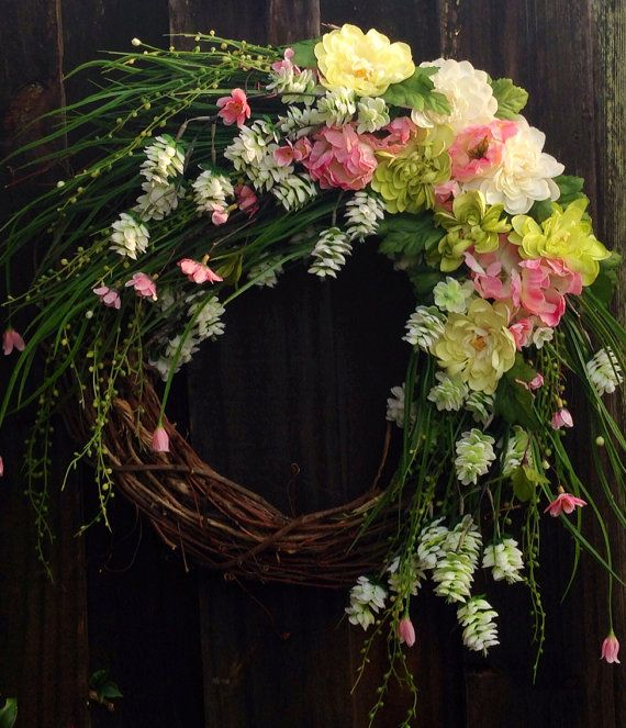 Whimsical Spring or Summer wreath with dramatic, draping faux florals in white, green, pink, and yellow.   on Etsy, $60.00