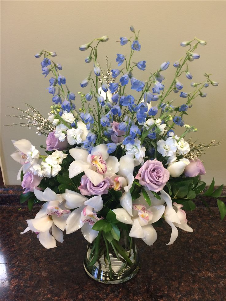 Orchids, roses and delphiniums