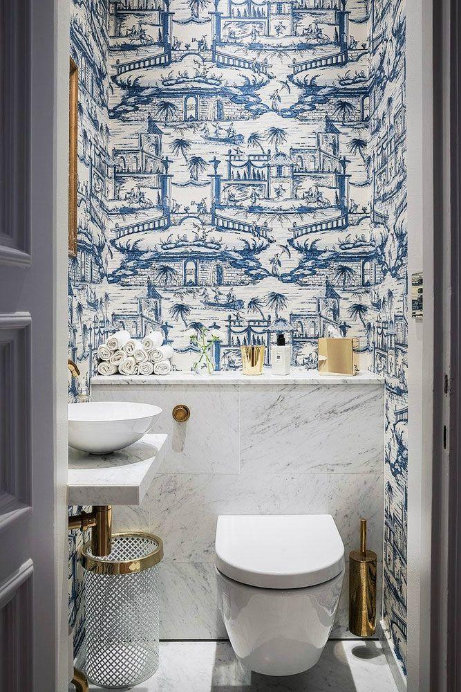 A Parisian Styled Bathroom design idea with white&blue tile