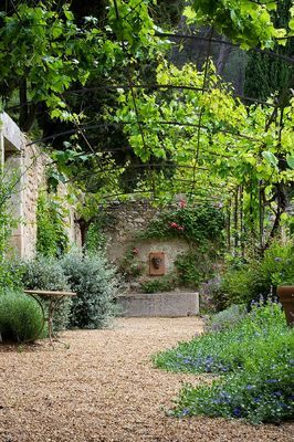 Garden with a gravel floor. PIERREDON GARDEN, PROVENCE, FRANCE - DESIGNER DOMINIQUE LAFOURCADE. Photo by Clive Nichols.