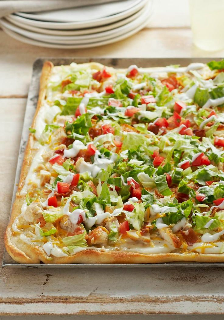 Chicken Club Pizza -- Chicken, bacon, lettuce and tomato come together for a deli fave translated into a melty, hot pizza. Get all the flavors of a delicious club sandwich in every bite.