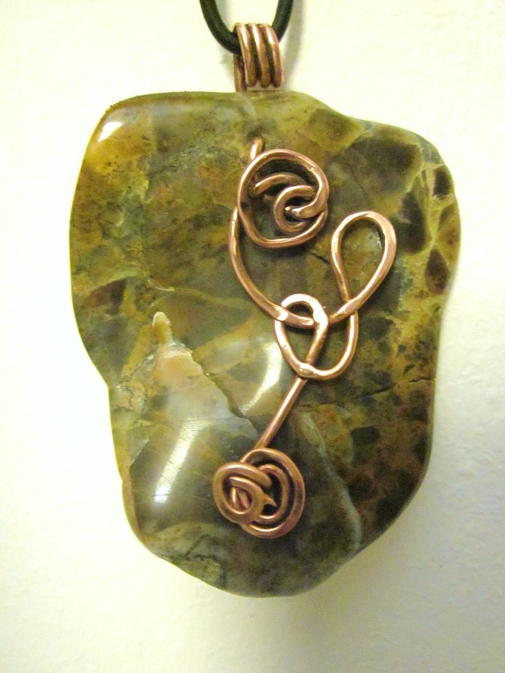 An amazing petrified wood pendant with many transparent points and the symbol of compassion and endless love made in copper.Petrified Wood teaches us patience and helps us to understand how to allow life to evolve in perfection. Working with its grounding energies can encourage one to live life as a spiritual being within this physical realm.