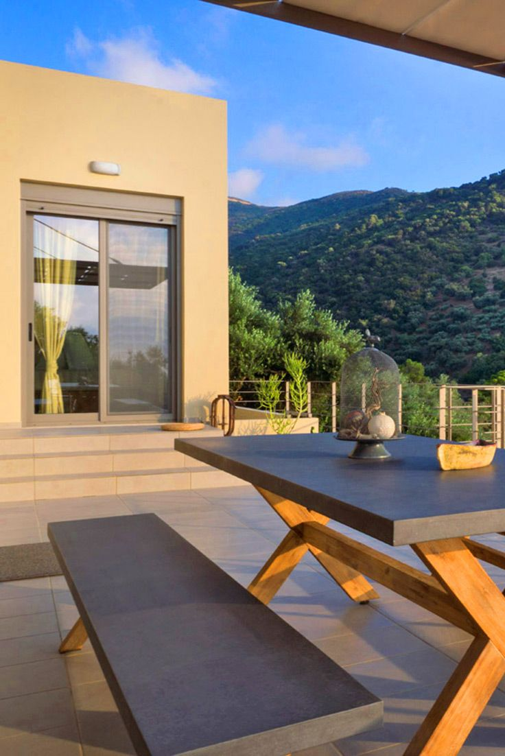 Outdoor sitting area with mountain view in Villa Levade, Sfinari, Chania. Visit our site TheHotel.gr for more Family Villas! #crete #familyvacation