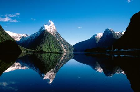 Mitre Peak stands above Milford Sound in the Fiordland region of New Zealand. It apparently resembles the mitre hat worn by Bishops. It is one of the countries most visited and photographed natural features.
