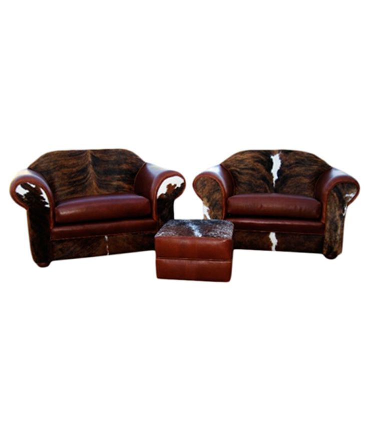 "If what you need is a ""manly"" chair, this is it. Generous proportions, rugged looking hair-on-hide and dark brown leather, and clean lines will have any cowboy, whether western or urban, heading straight to the Rocky Mountain Chair and a Half. It's straight forward design makes it look great as part of a pair, as shown, or with a matching sofa. Price is for options as shown in photo. View pricing for other size options HERE and other embellishment options HERE."