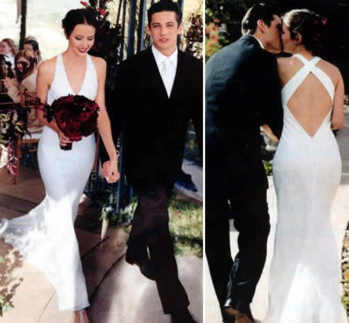 Actress Amy Acker, married James Carpinello on April 25, 2003. Amy wore a sheath gown by Reva Mivasagar and carried a bouquet of red roses, chocolate cosmos, and crystals.