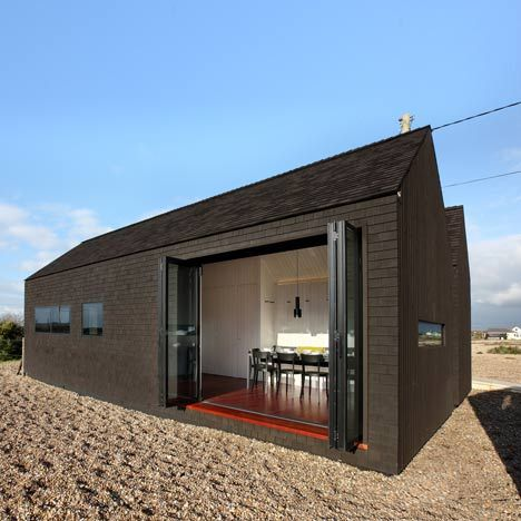 Located on a beach in Dungeness, Kent, this house is clad in tarred black shingles.