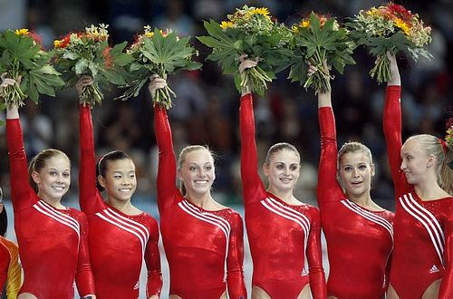 First placed U.S. gymnasts Shawn Johnson, Ivana Hong, Samantha Peszek, Shaya Worley, Alicia Sacramone and Anastasia Liukin, from left, raise bouquets of flowers during a winners ceremony after the women's team final of the Gymnastics World Championships in Stuttgart, southern Germany, on Wednesday, Sept. 5, 2007. The 40th Gymnastics World Championships take place in Stuttgart from Sept. 1 to Sept. 9, 2007. (AP Photo/Michael Sohn)