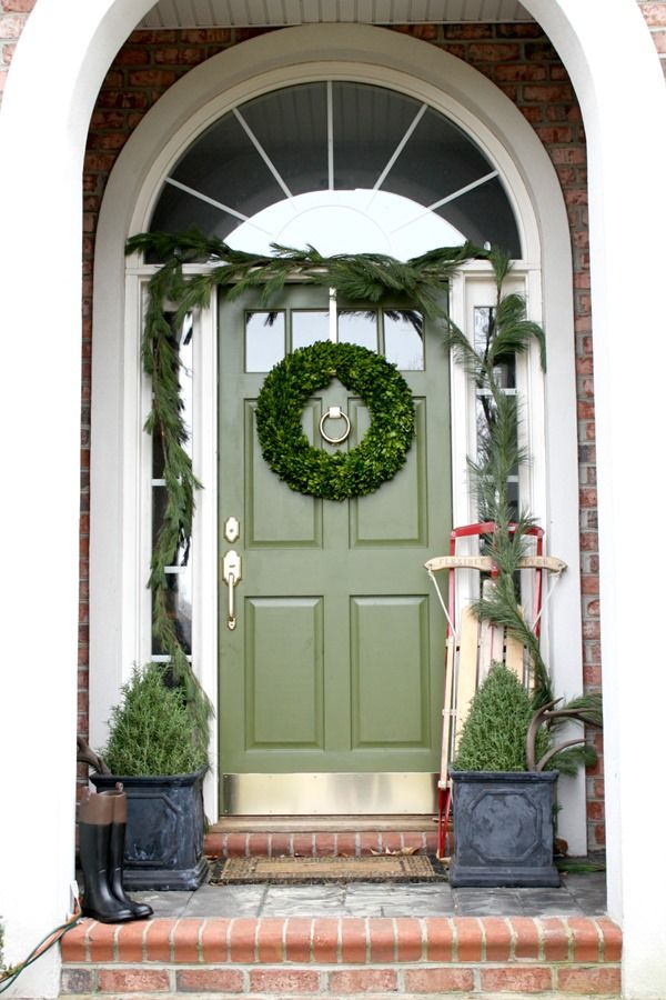 green front door with garland, boxwood wreath and rosemary trees (and more pics of our house at Christmas)