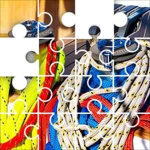 Yacht Ropes Jigsaw Puzzle, 67 Piece Classic. Colorful ropes draped around capstans on a wood deck sailing