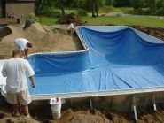 After pool basing, our vinyl liners are dropped into the pool and stretched to the dimensions.
