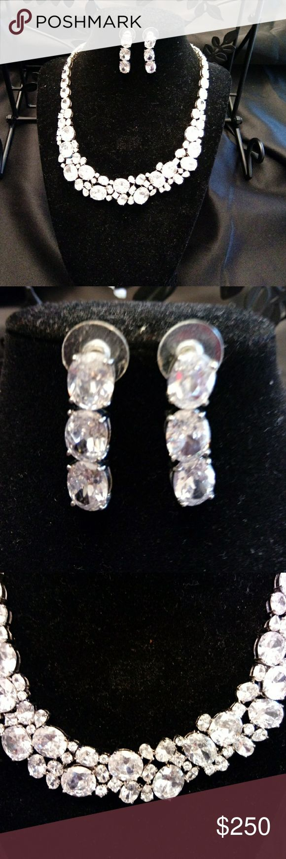 """Neclace 16""""length, earrings 1 1/4 long, earrings drop 3/4 long. Earrings are post with 3 CZ stones each. Necklace has a double lock on back. Cubic Zirconia Jewelry Necklaces"""