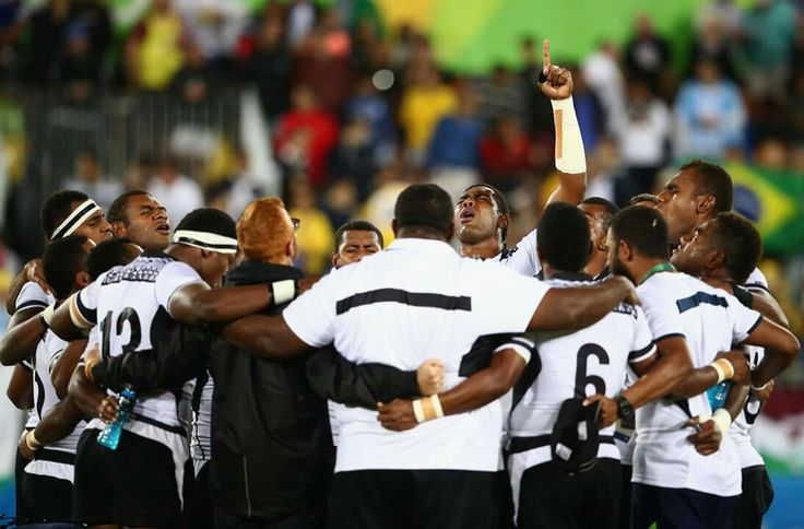 RIO DE JANEIRO, BRAZIL - AUGUST 11: Fiji players and staff huddle as they win gold after the Men's Rugby Sevens Gold medal final match between Fiji and Great Britain on Day 6 of the Rio 2016 Olympics at Deodoro Stadium on August 11, 2016 in Rio de Janeiro, Brazil. (Photo by Mark Kolbe/Getty Images)